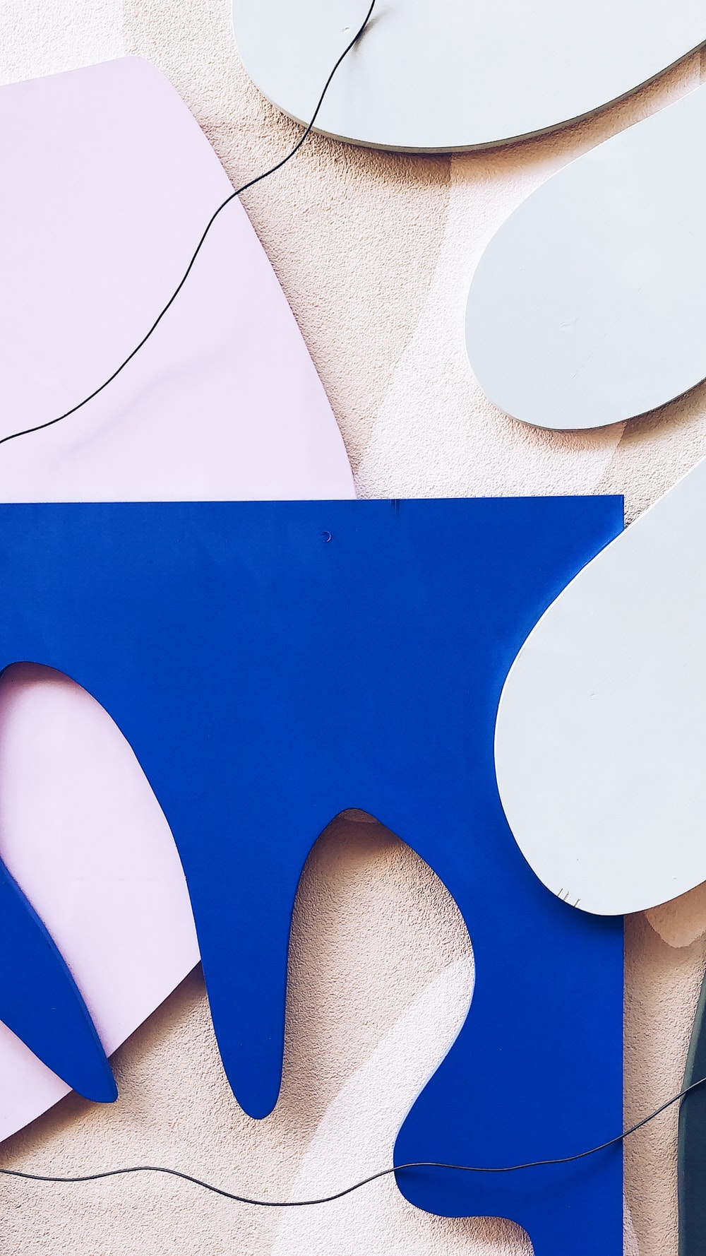 white and blue paper cutouts