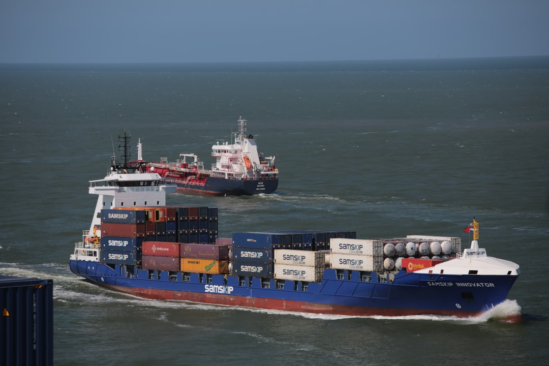 Container feeder boat approaching port of Rotterdam.