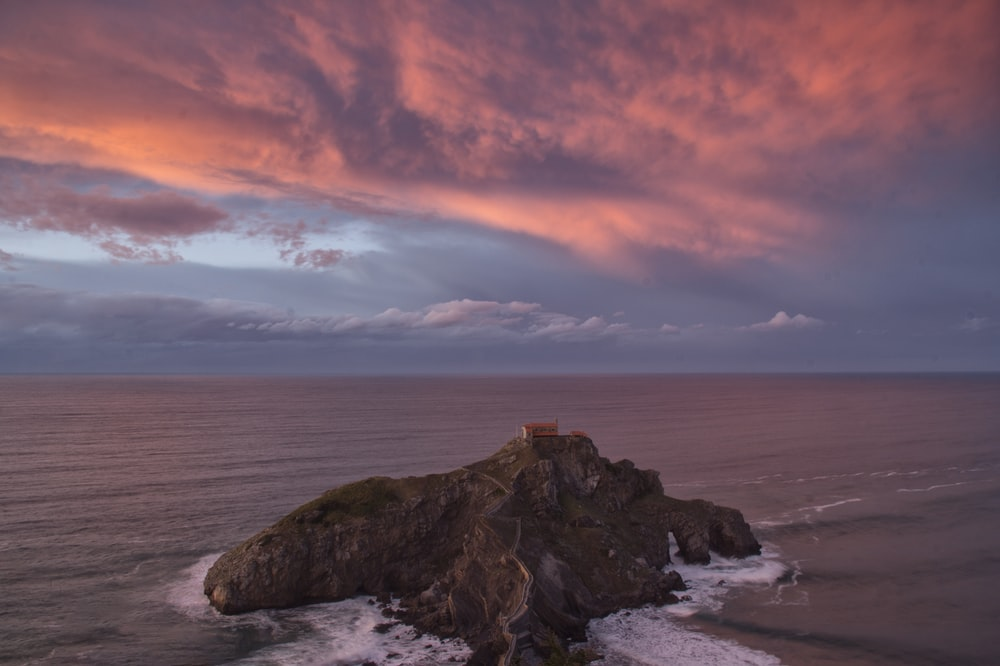 black rock formation beside sea