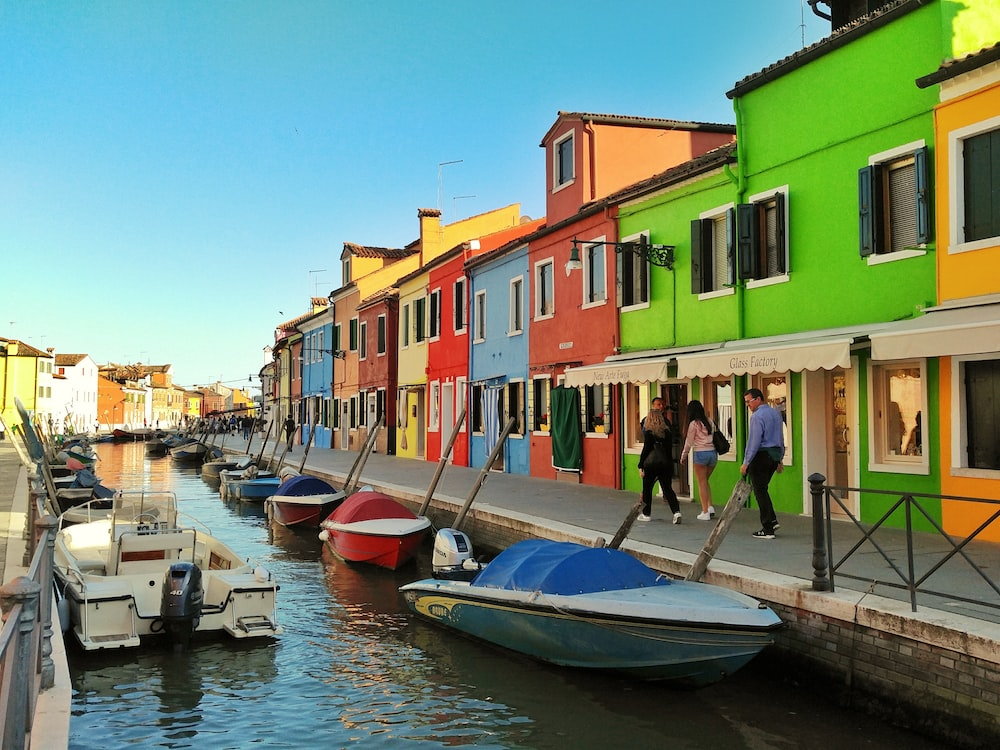 motorboats parked beside multicolored houses