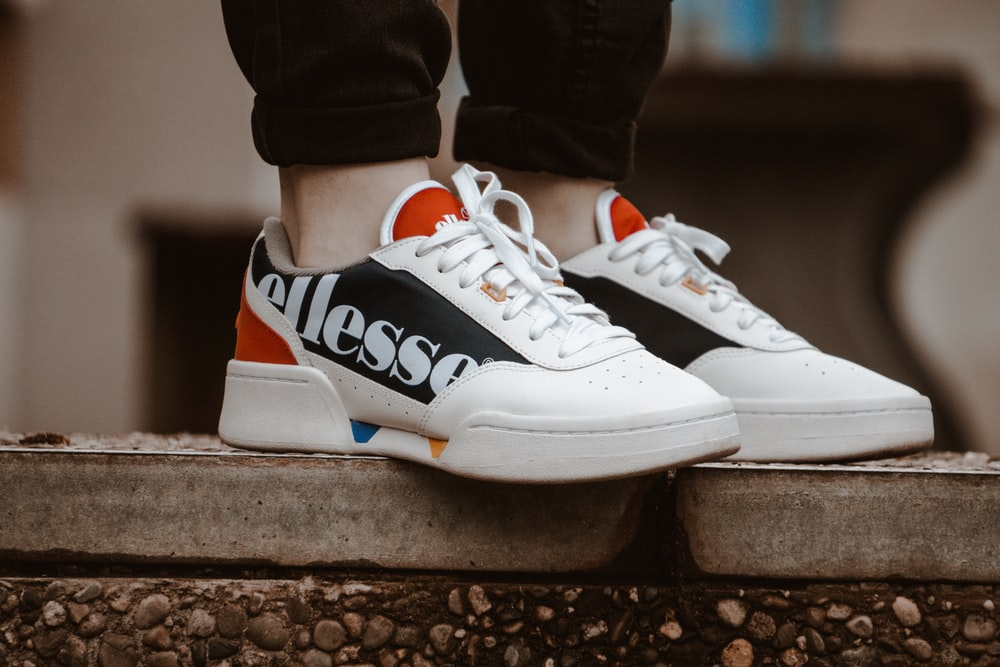 pair of white-and-black Ellesse lace-up low-top sneakers