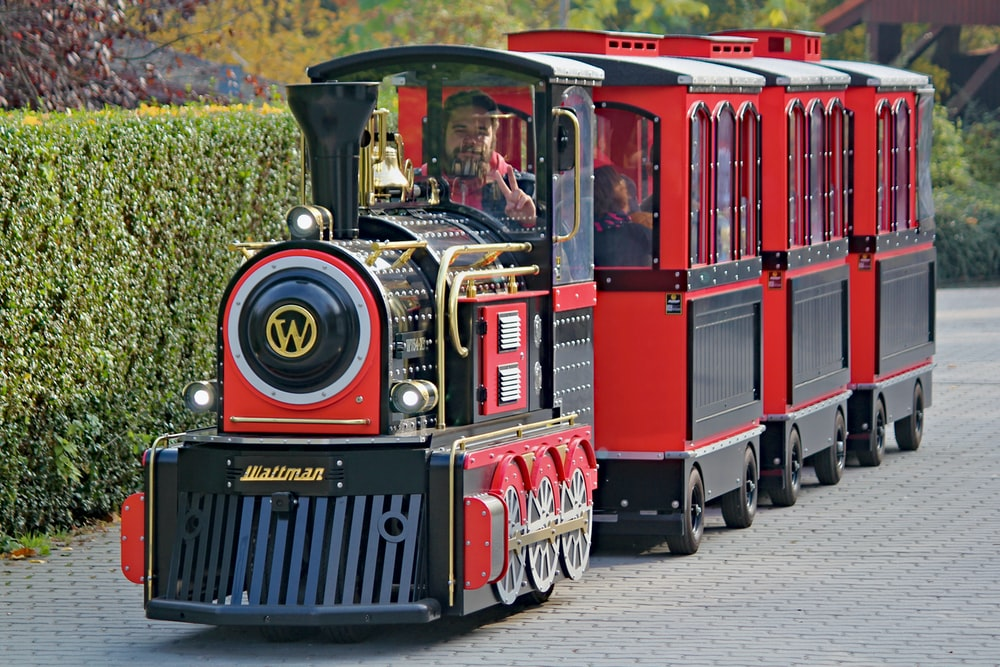 red and black train at the park