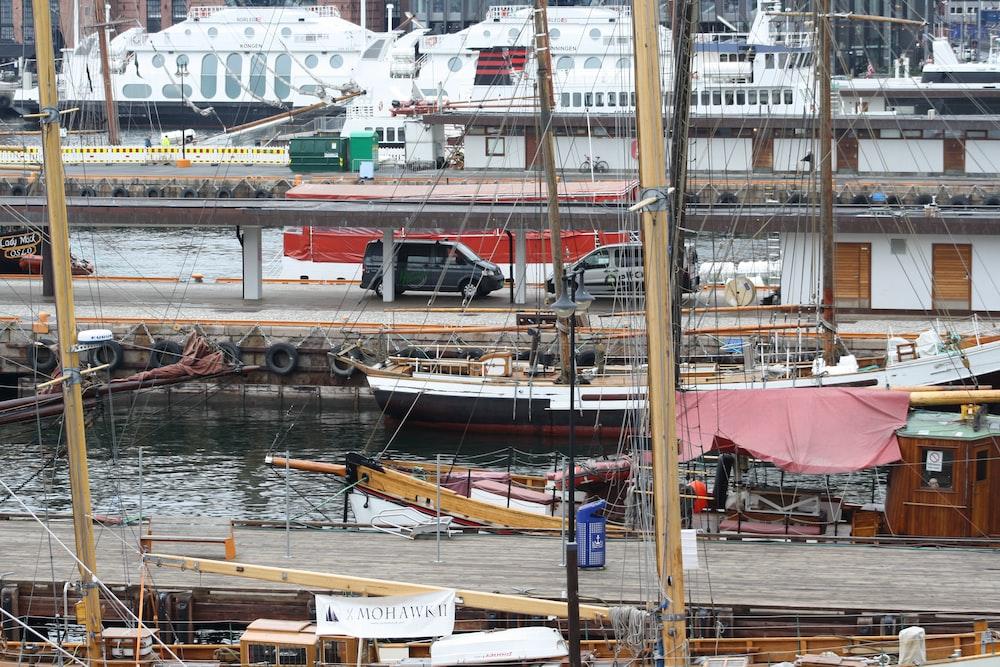 two vehicles park at marina