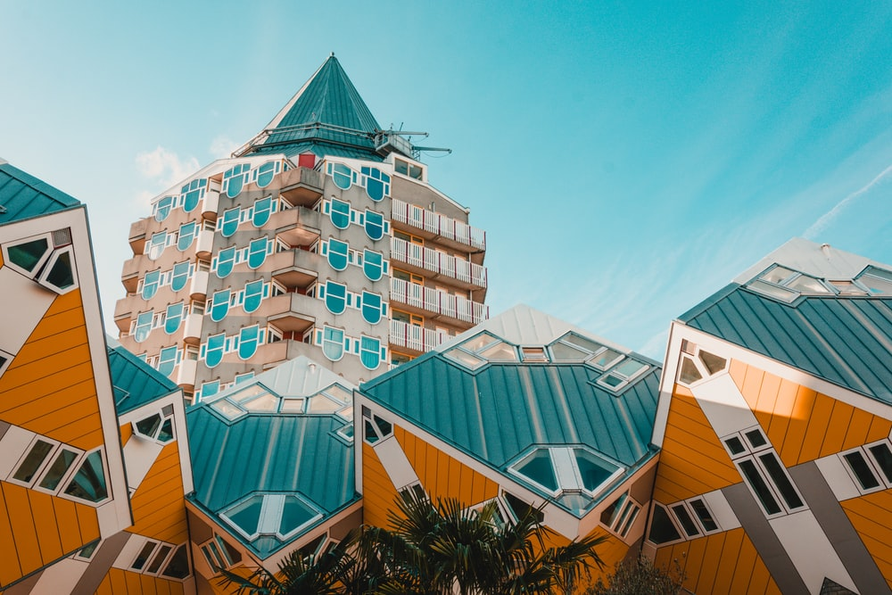 low angle photography of white, blue, and yellow concrete building