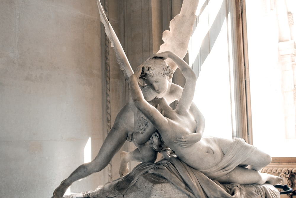 woman and angel kissing statue