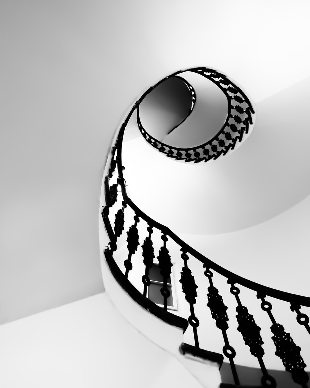 structural photography of spiral house stairs