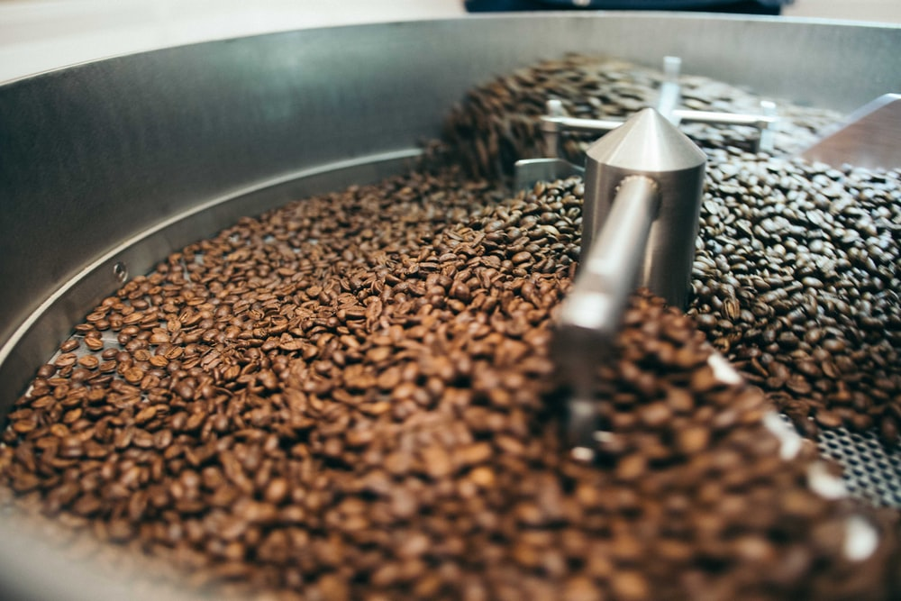 coffee beans on grinde r