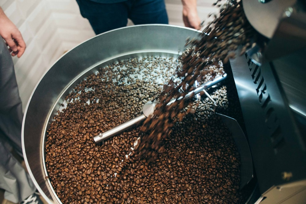 pouring coffee beans in bowl