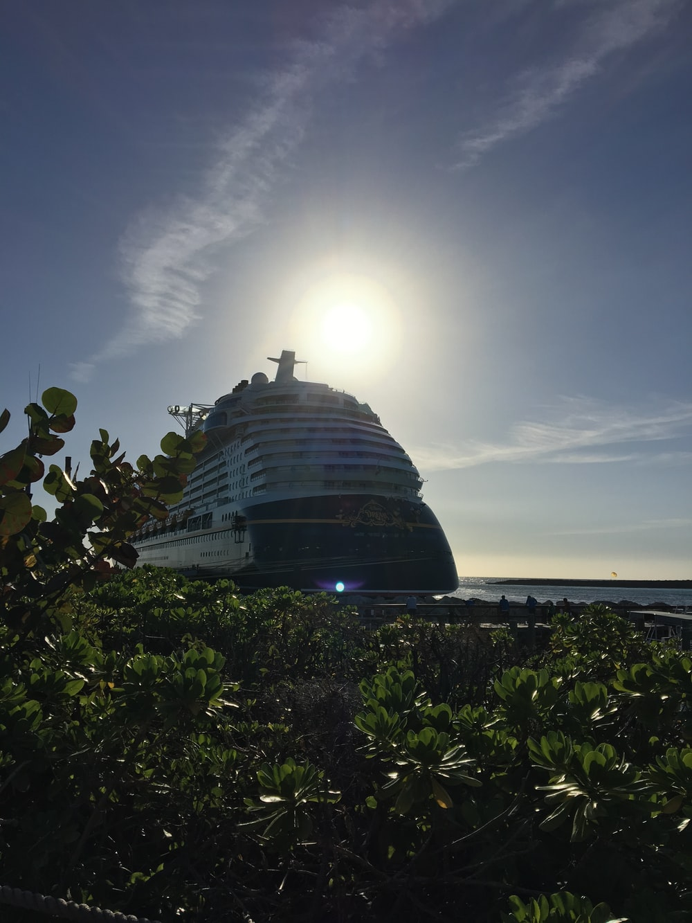 white cruise ship under ray of the sun