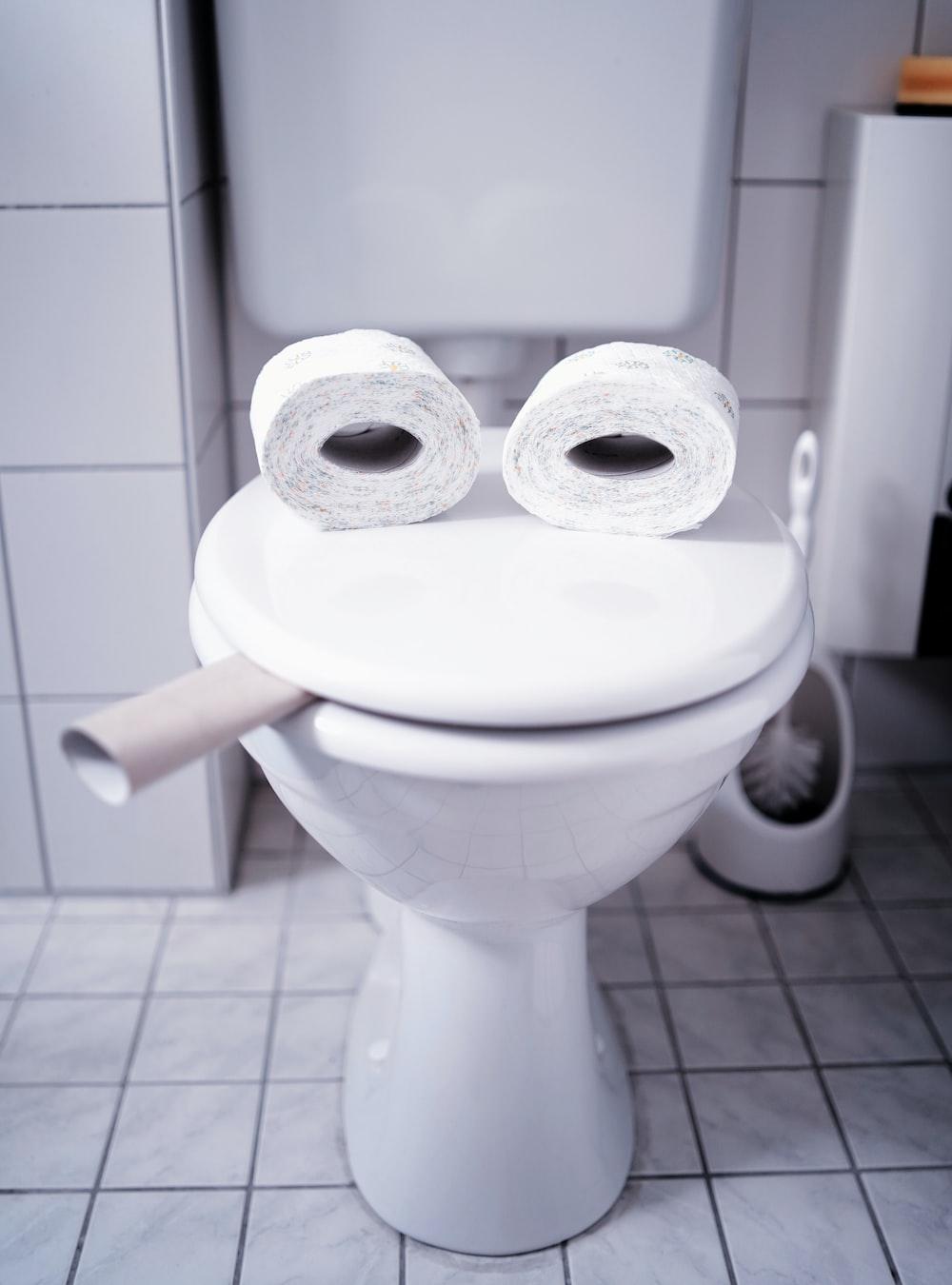 white toilet paper on flush toilet