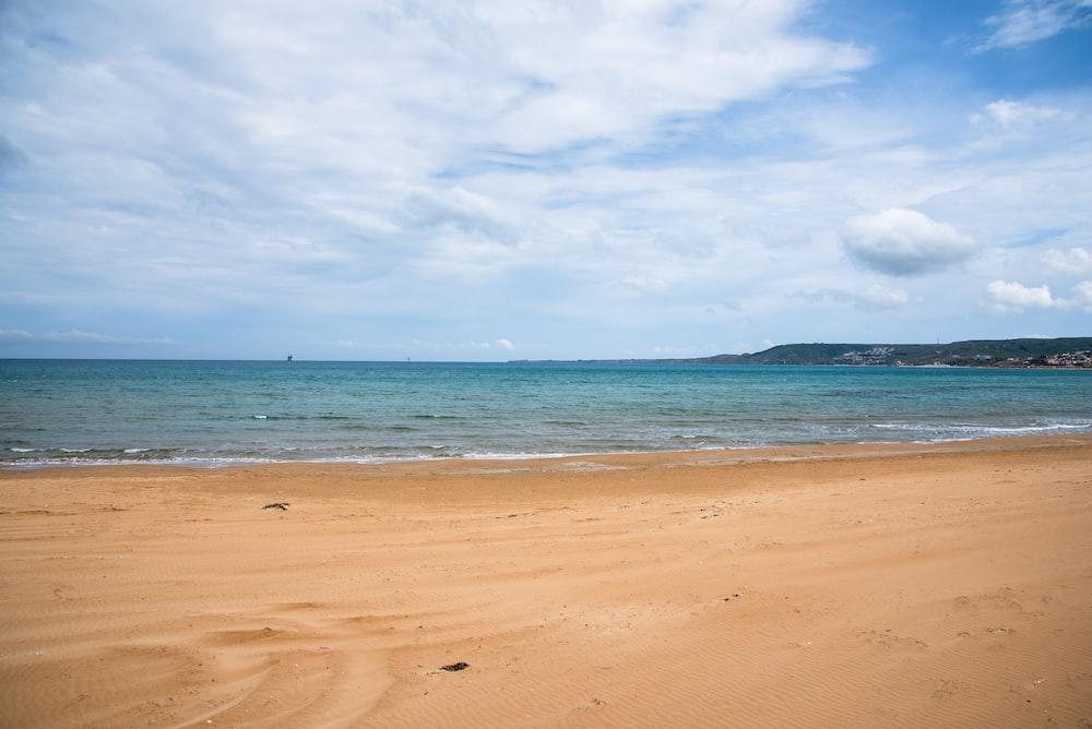 beach line under white sky