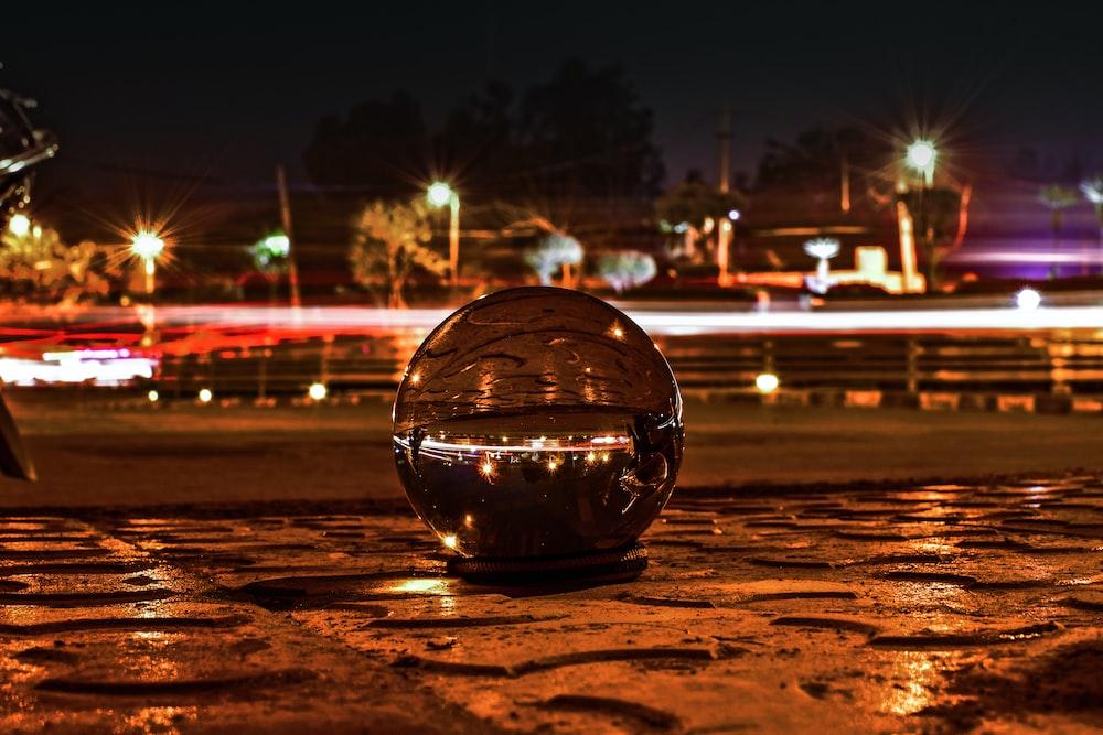 clear glass ball photo across lights
