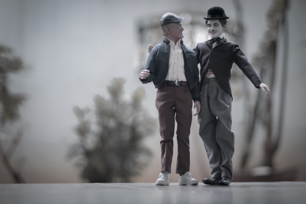 shallow focus photo of Charlie Chaplin figurine