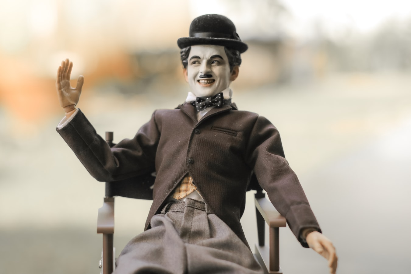 A Charlie Chaplain model with bowler hat and trademark moustache.