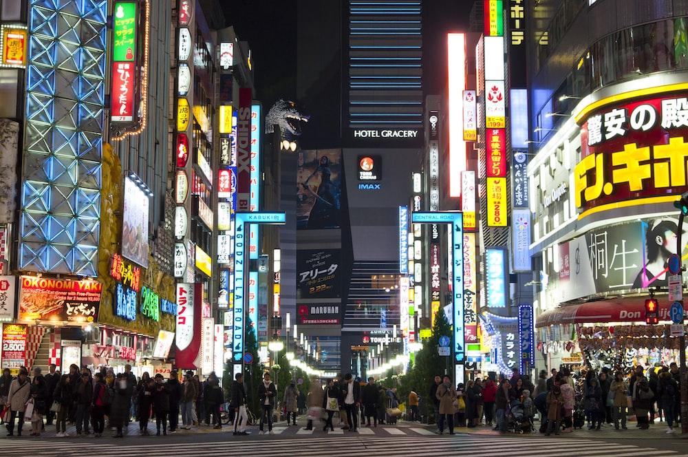 crowded pedestrian lane in urban area at night