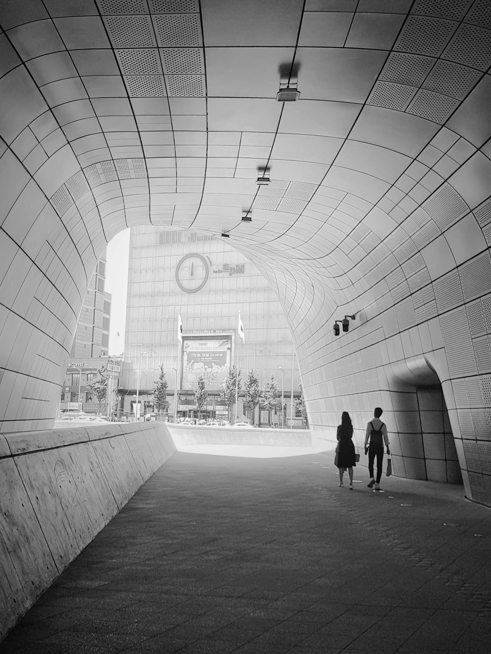 white concrete tunnel during daytime