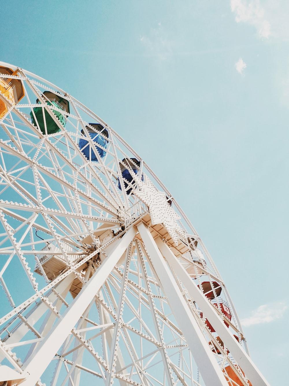 white Ferris wheel across blue sky