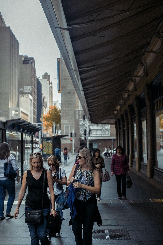 group of women walking on streets