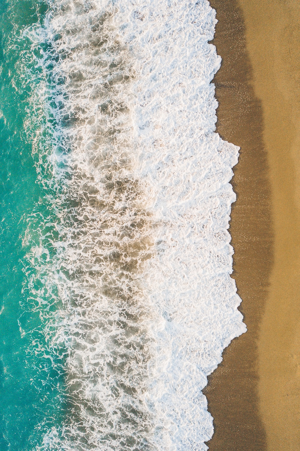 aerial view of sea wave during daytime