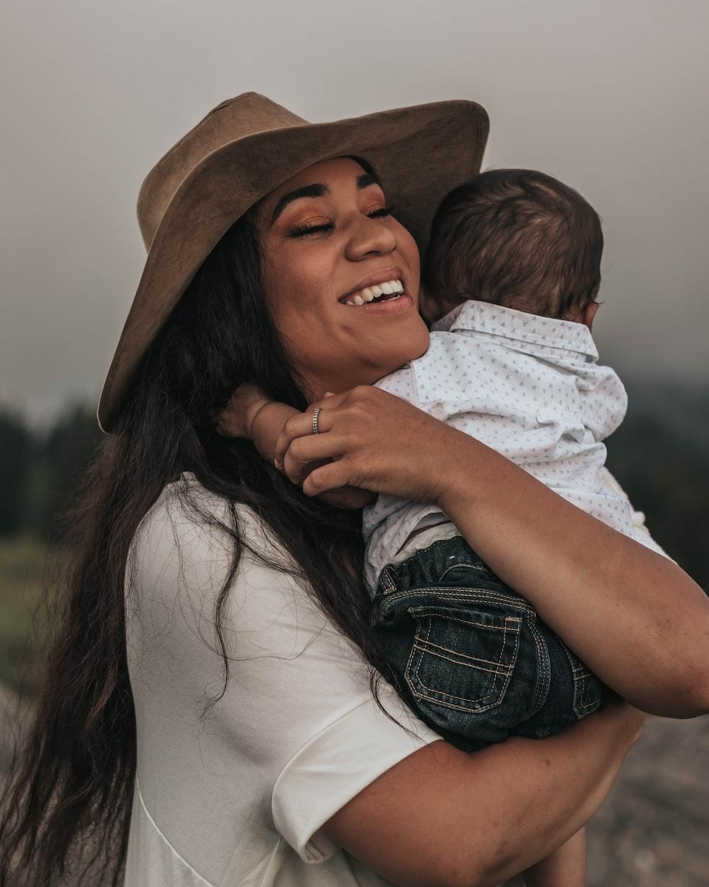 woman hugging baby