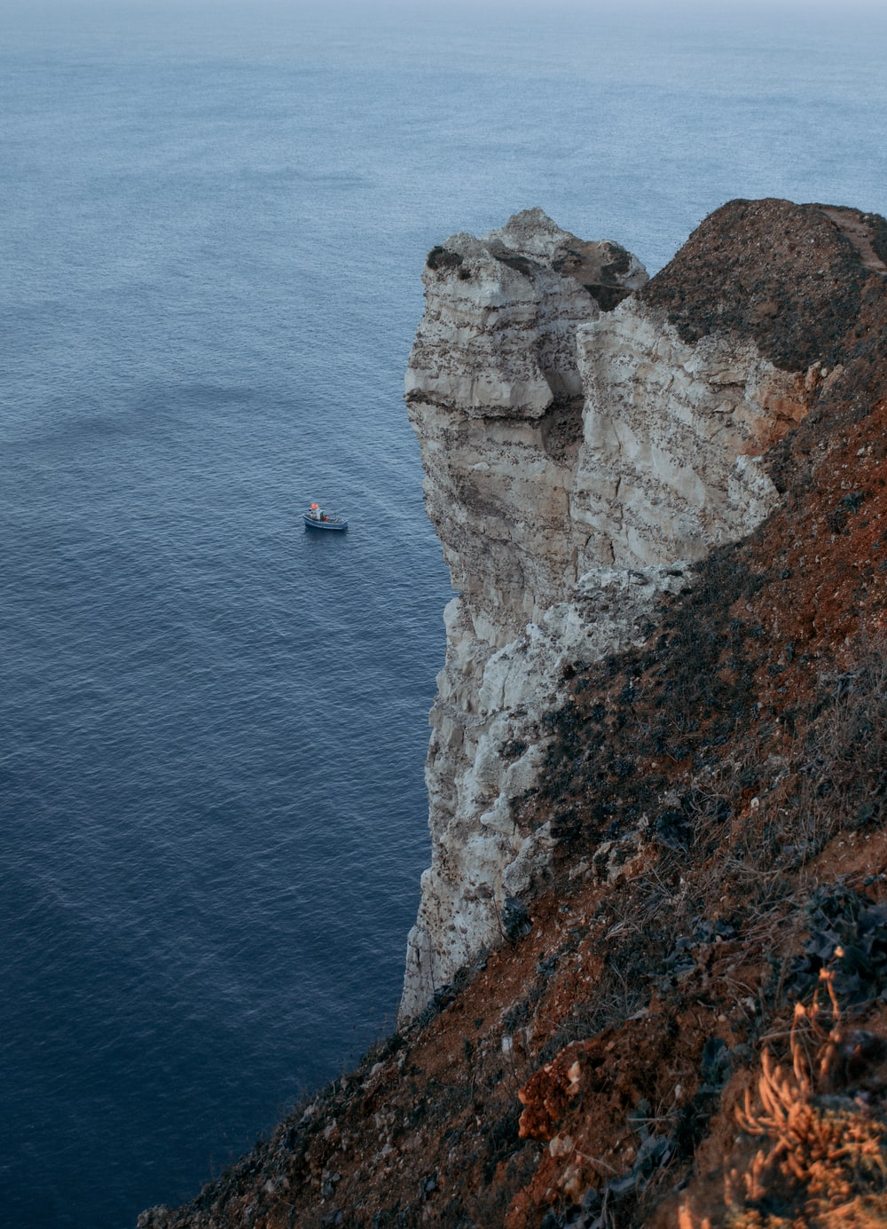 aerial photography of cliff near body of water during daytime