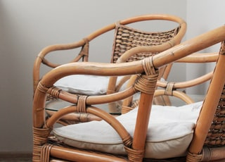 two brown rattan armchairs photo
