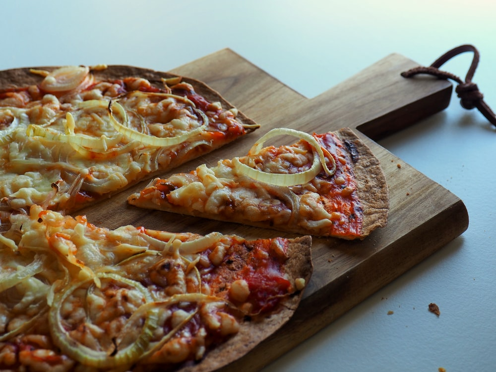 baked pizza pie on wooden tray