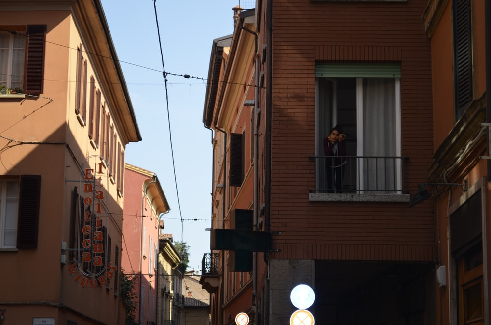 woman on balcony during daytime