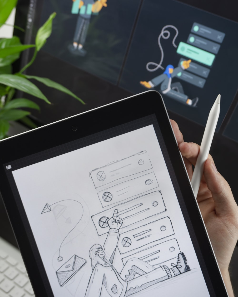 person drawing sketch on tablet