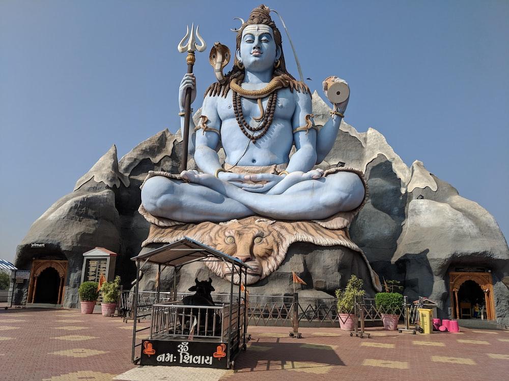 gray concrete buddha statue during daytime