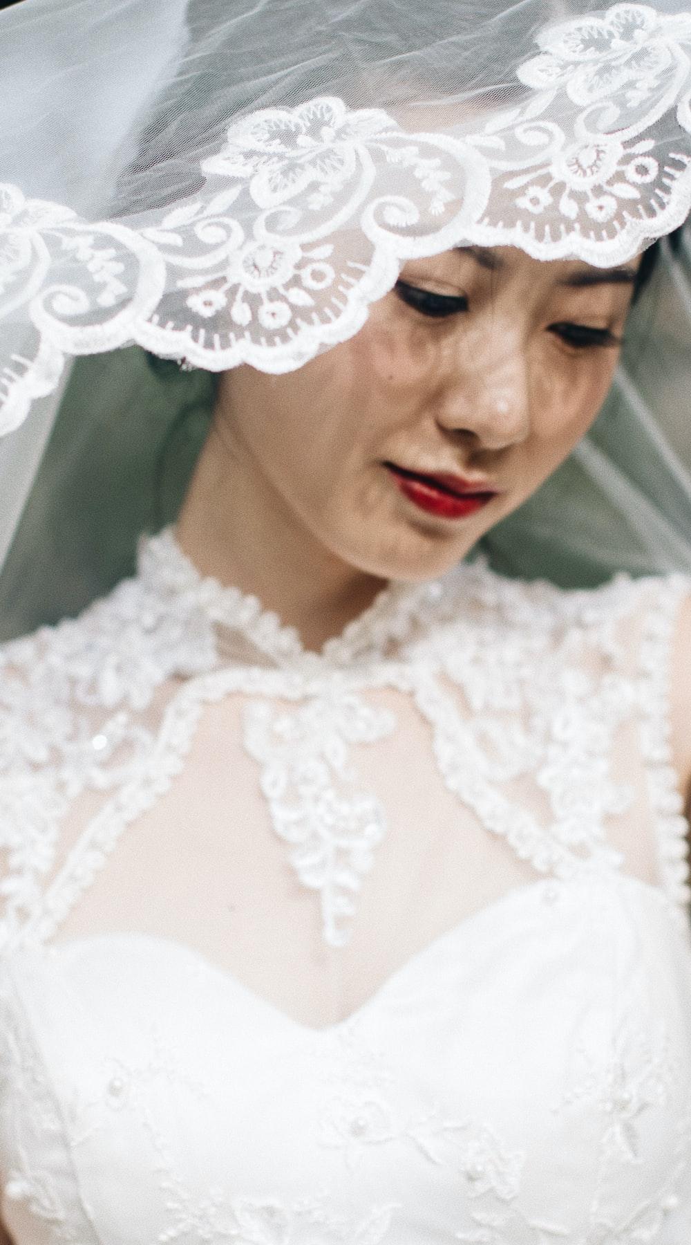 woman wearing white lace wedding dress