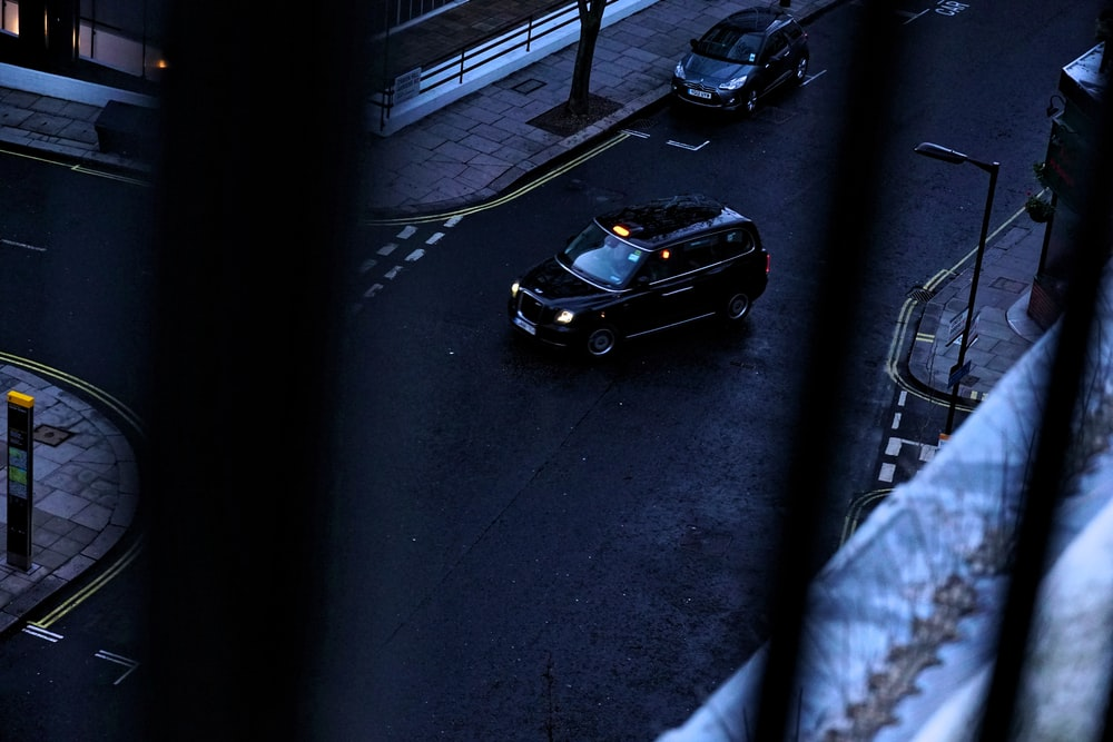 black vehicle about to turn right at the street