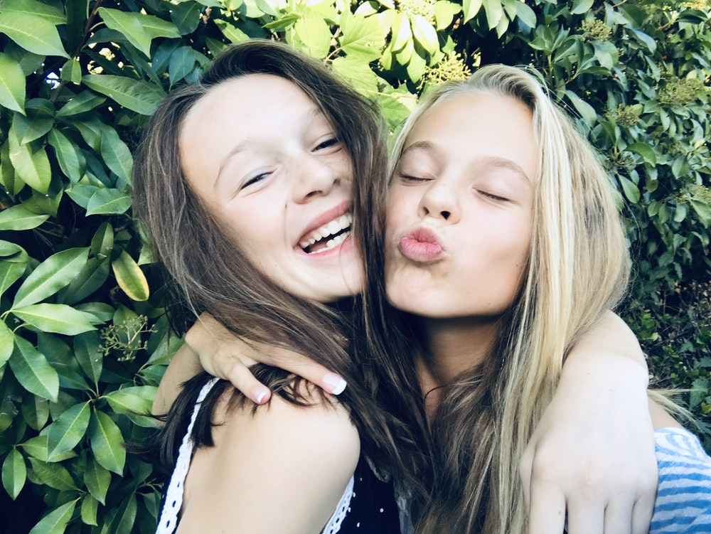 two girl making face