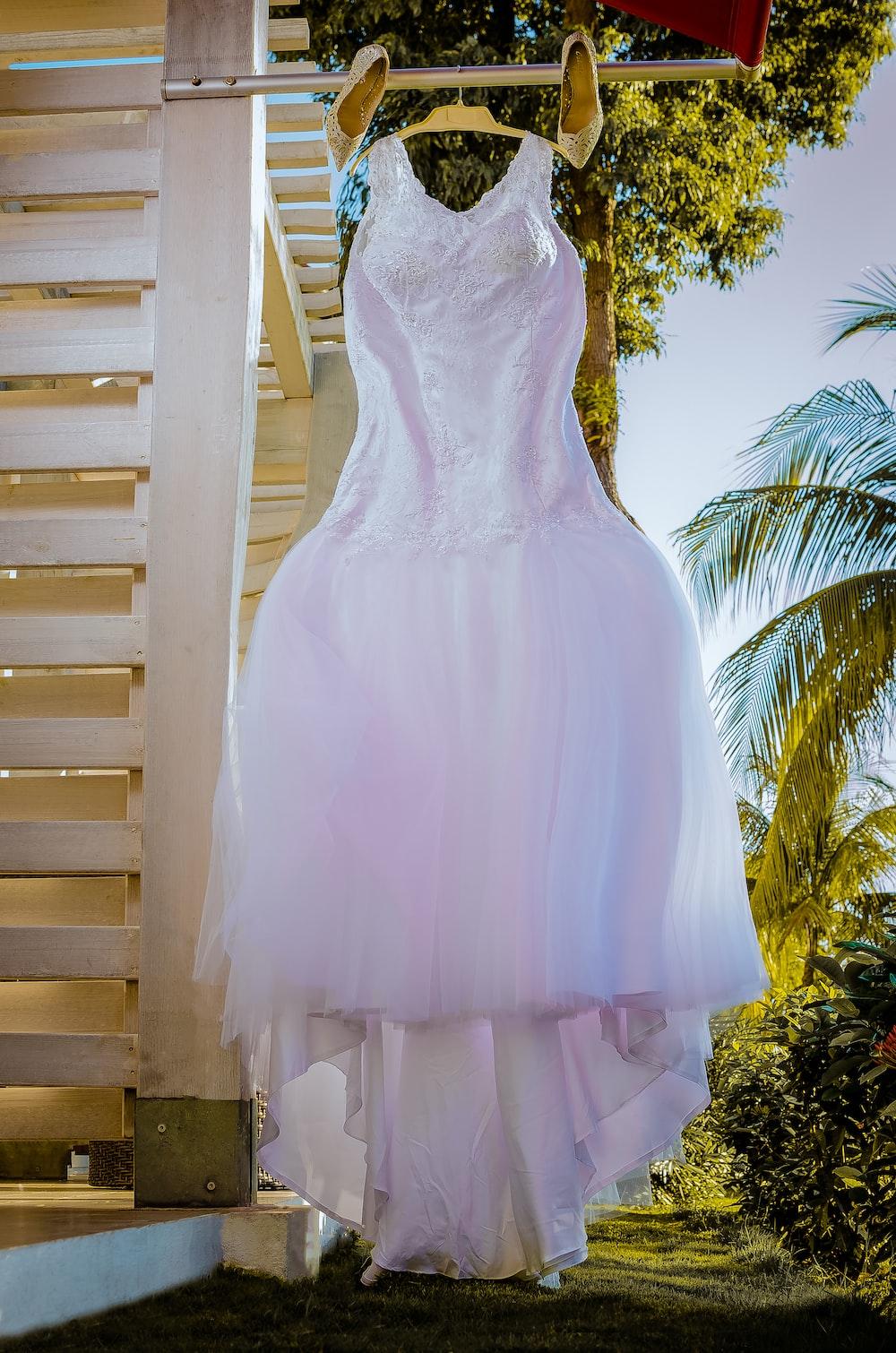 white tank wedding dress hanged
