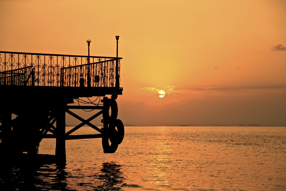 dock with handrail during golden hour