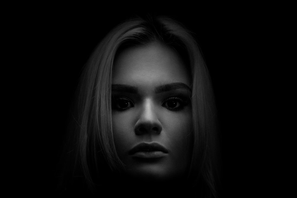 grayscale photo of woman's face