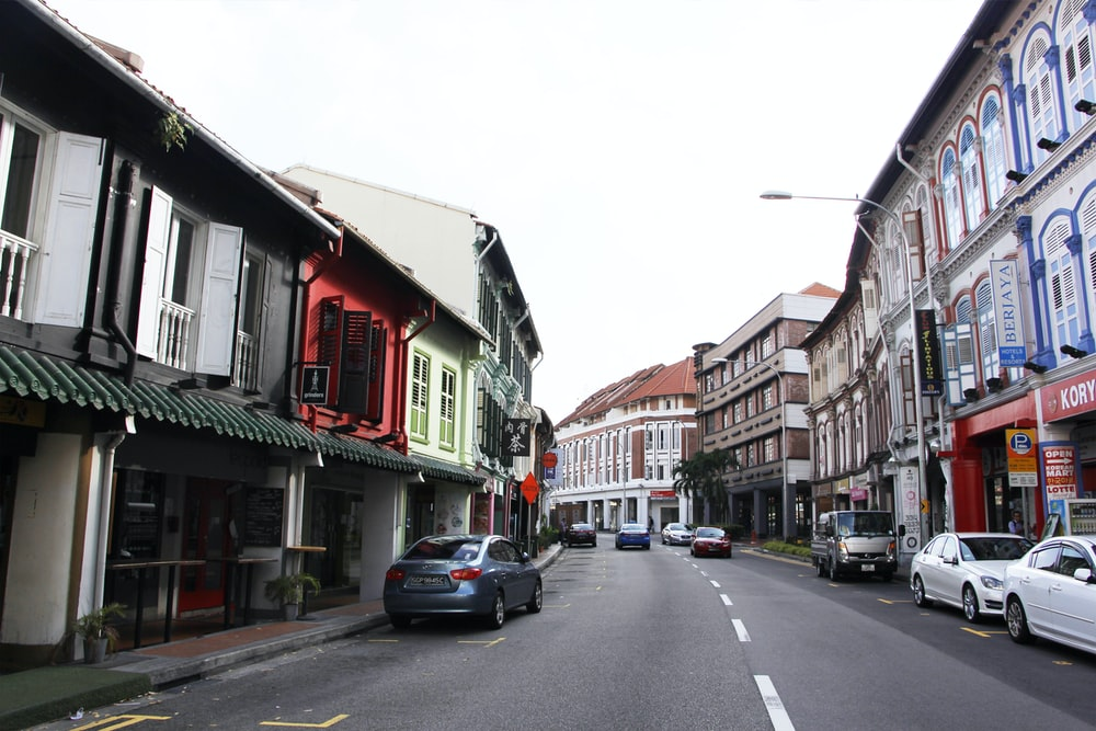 vehicles beside road and buildings