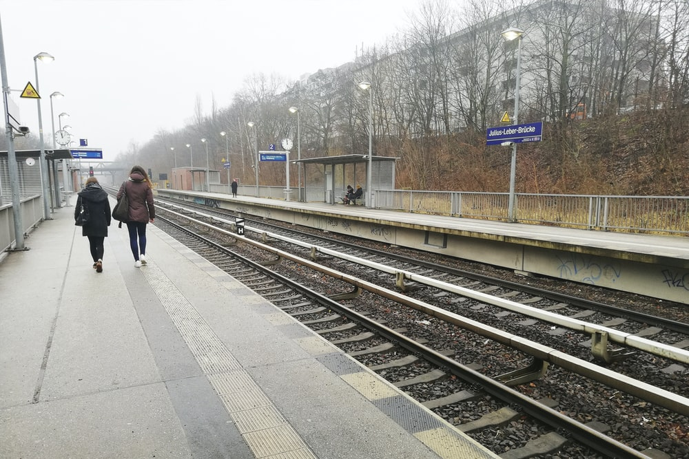 two people near train track