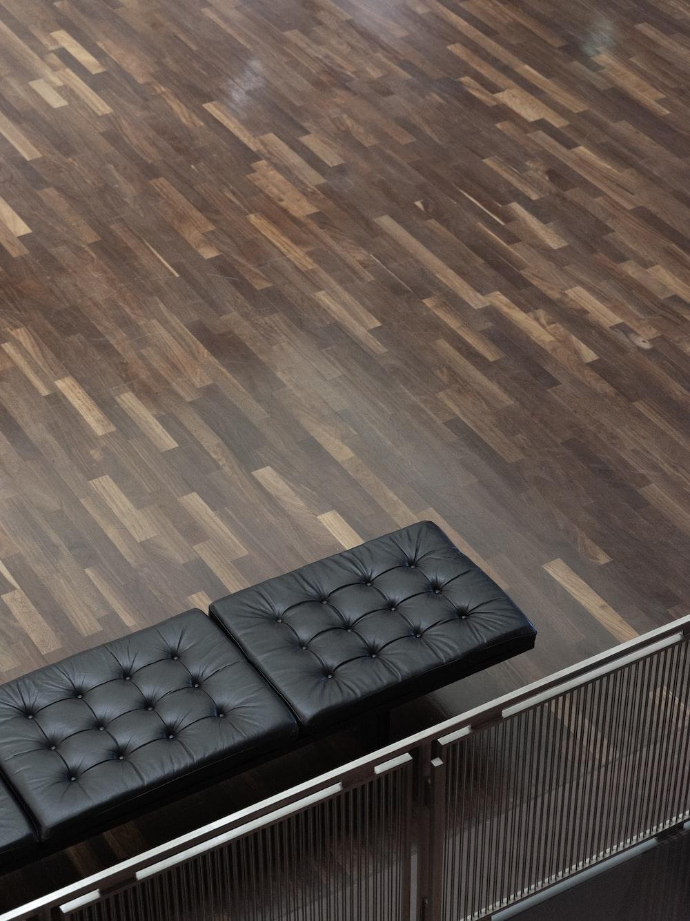 modern tufted black gang chair on parquet floor