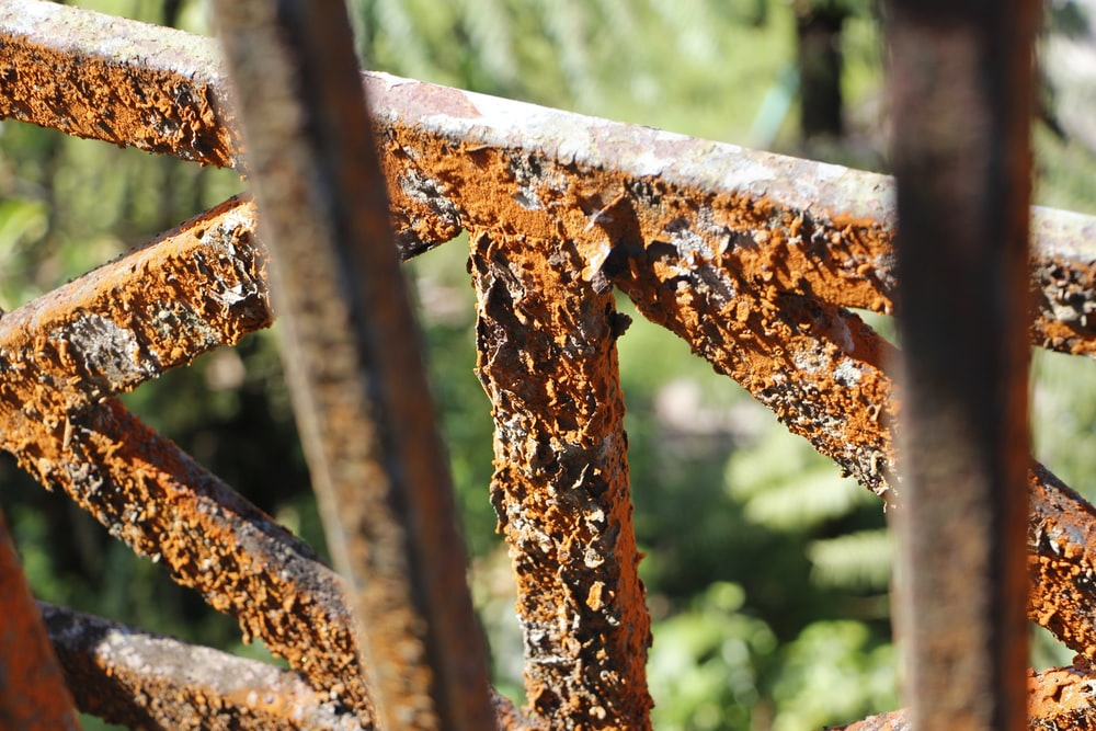 brown rust forming on metal railings