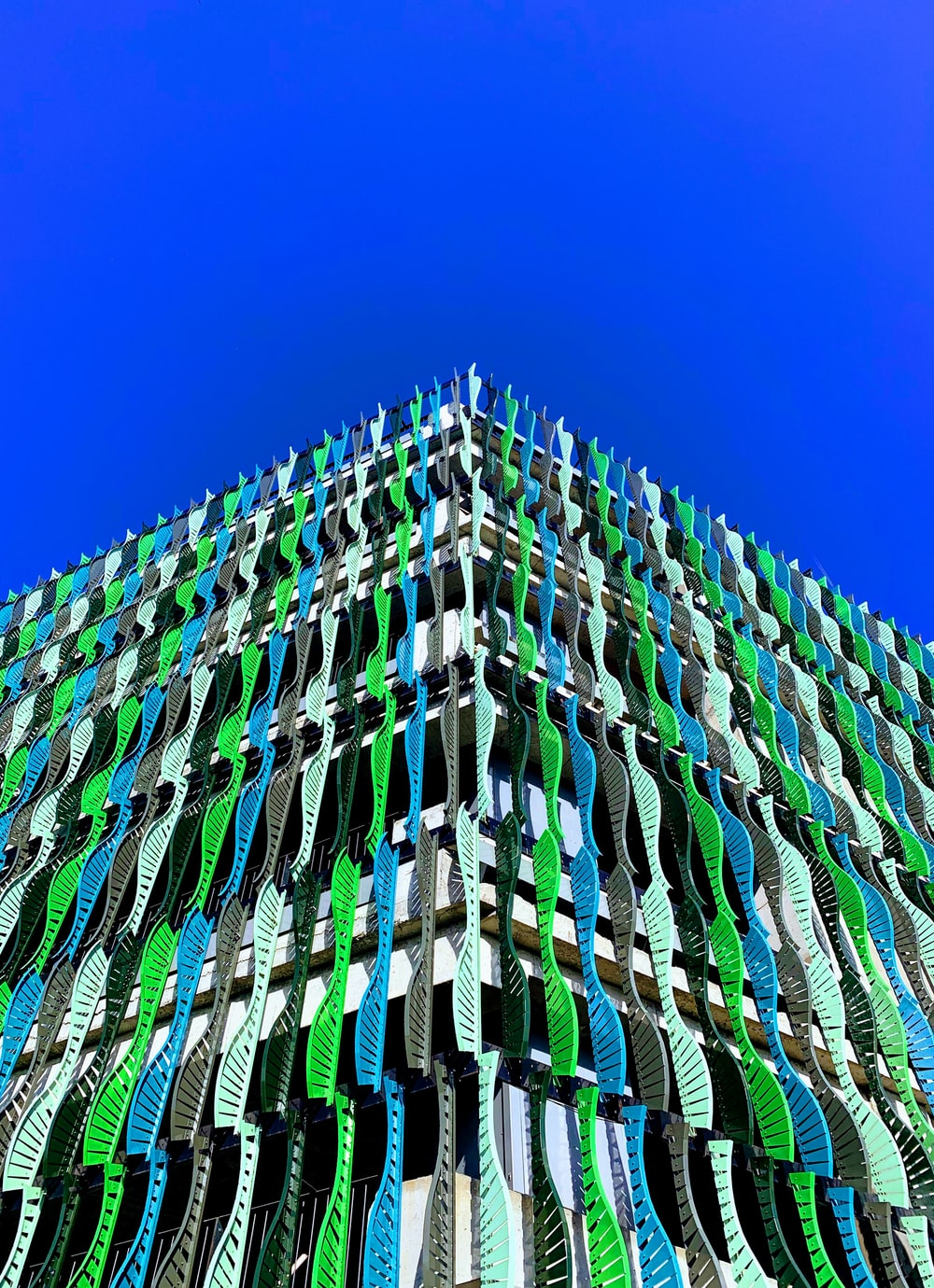 green and teal concrete building view