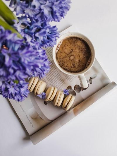 white ceramic mug and macaroons
