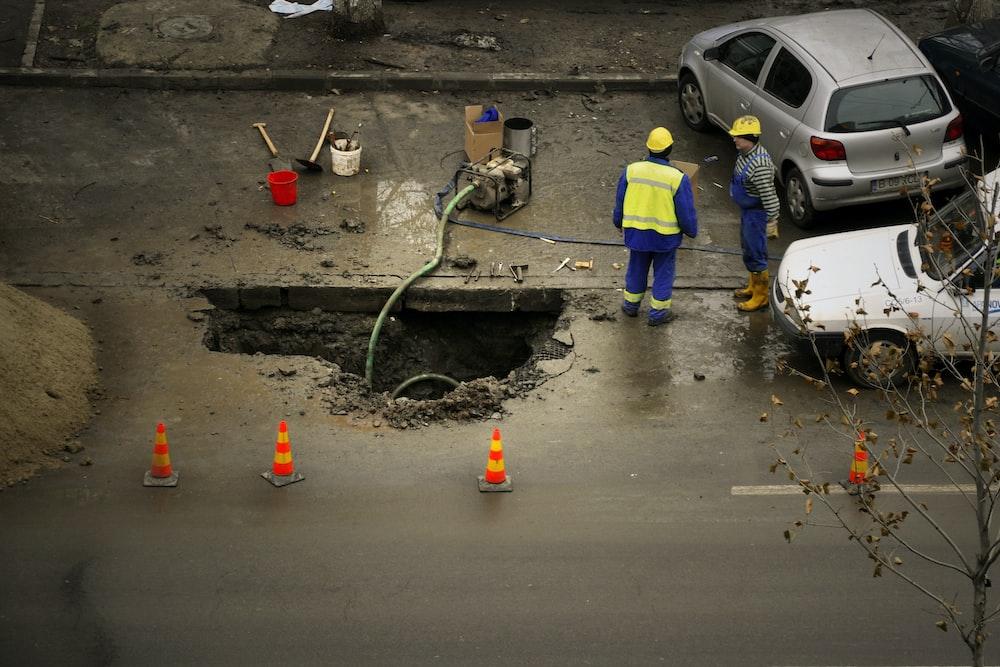 people fixing road