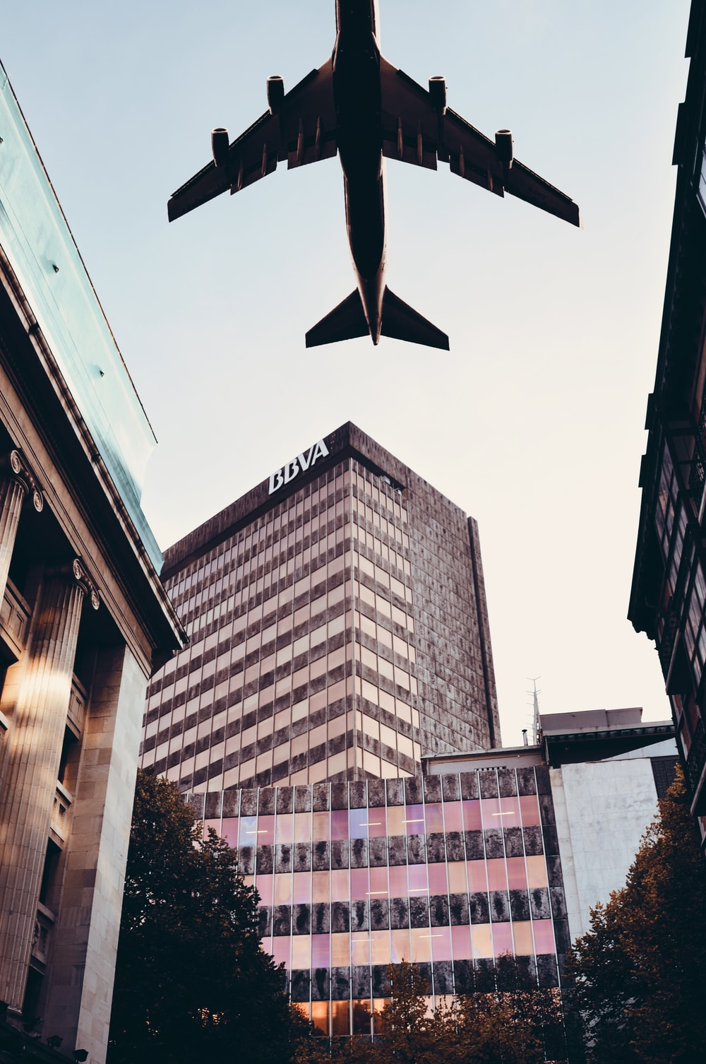 airplane above buildings