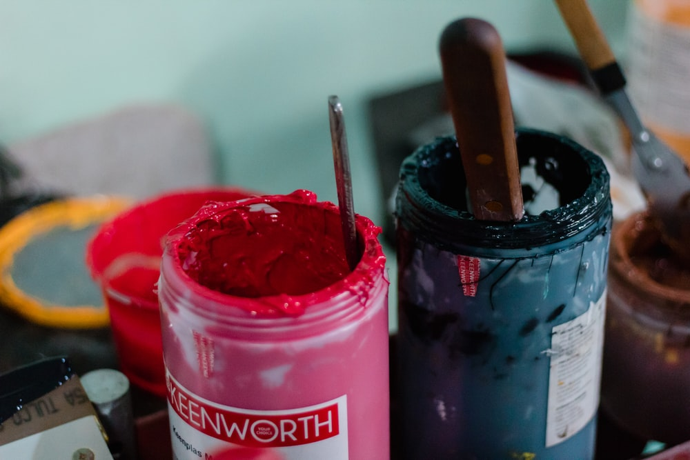 two green and pink paint jars