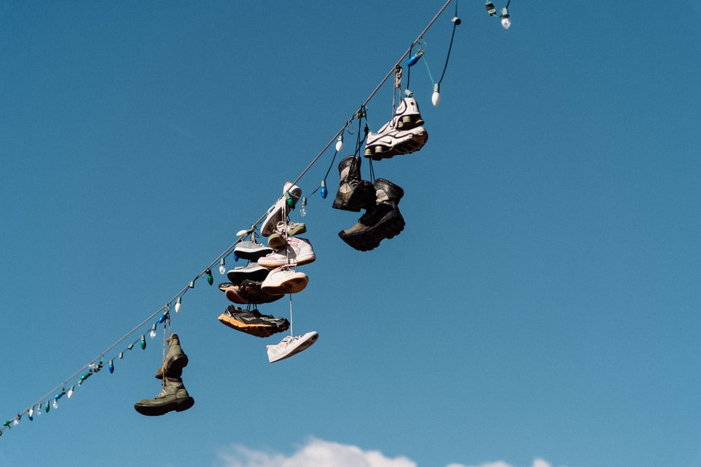 shoes hanging on string