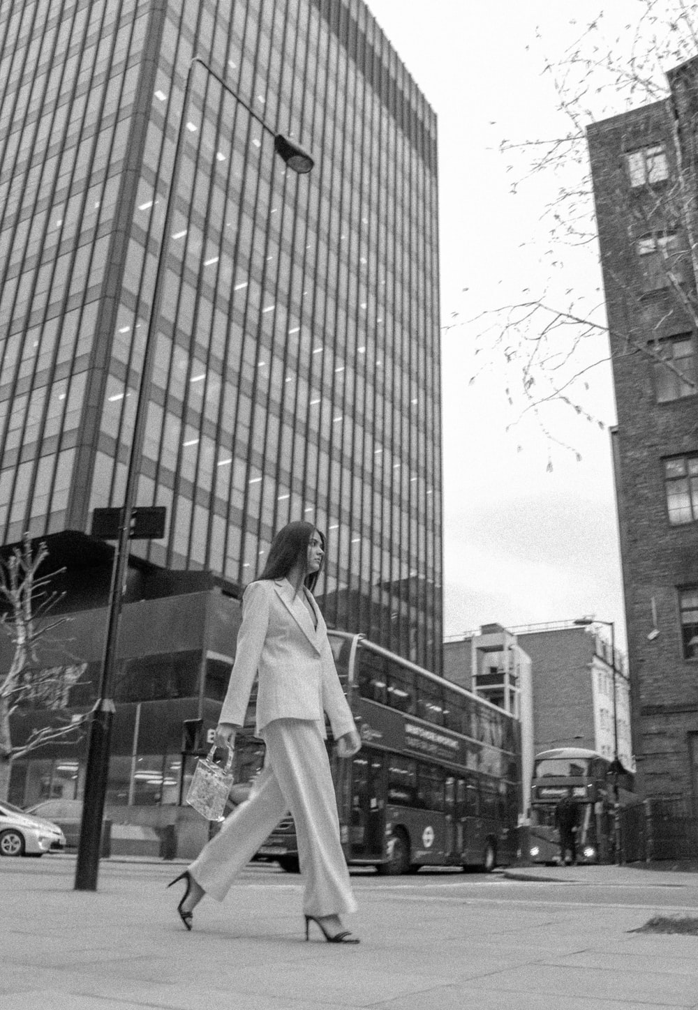 woman walking near buildings