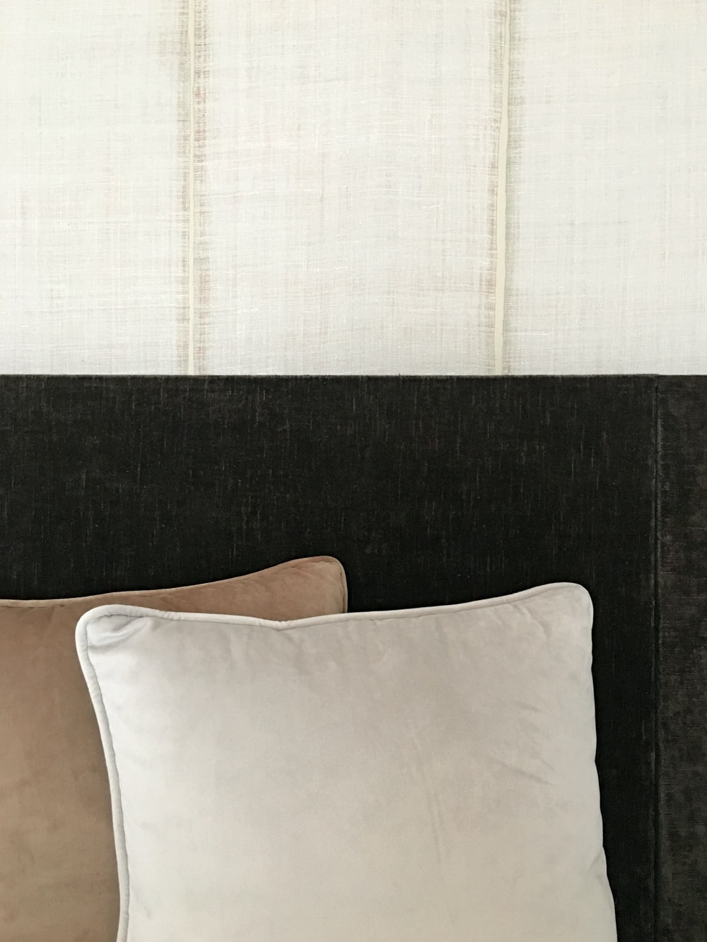 two brown and white throw pillows close-up photography