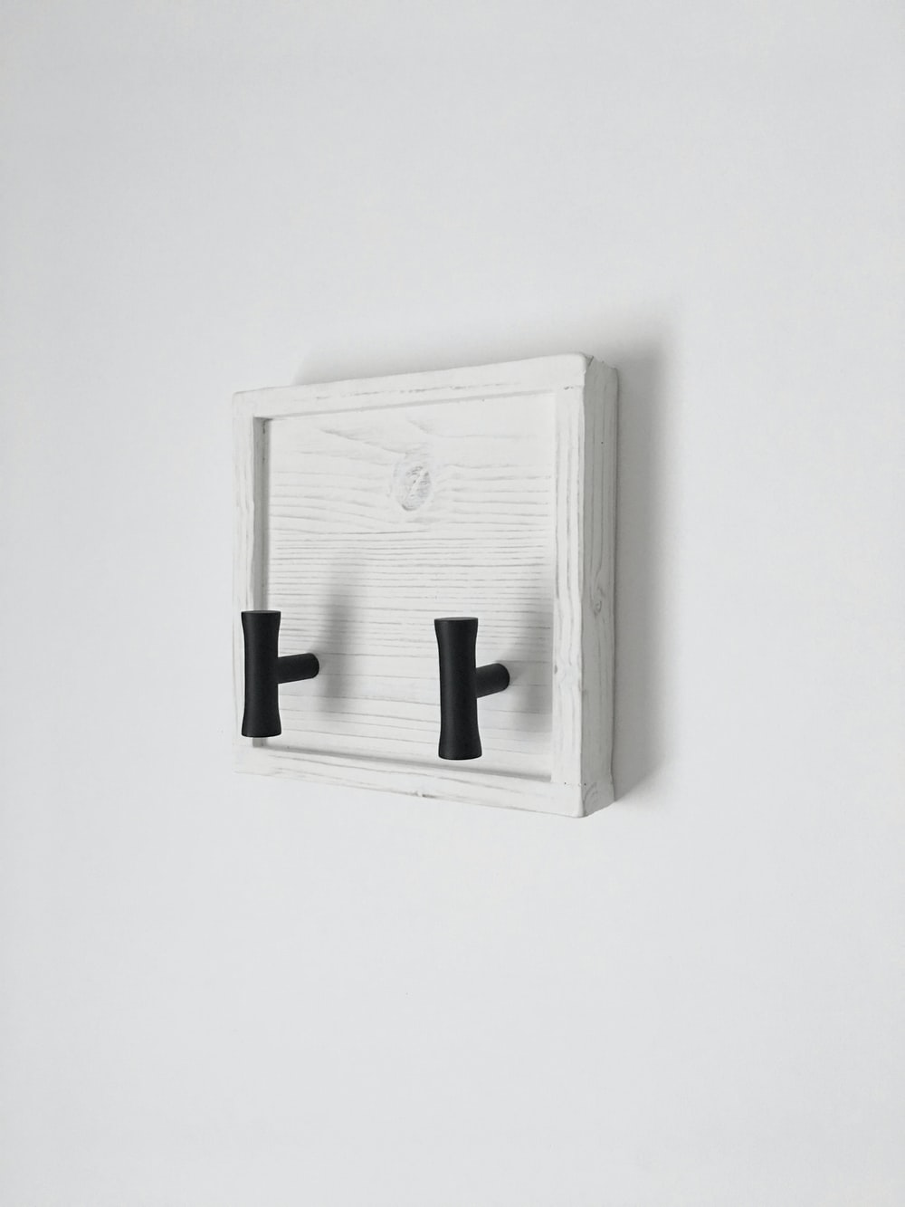 white and black wooden mini wall cabinet