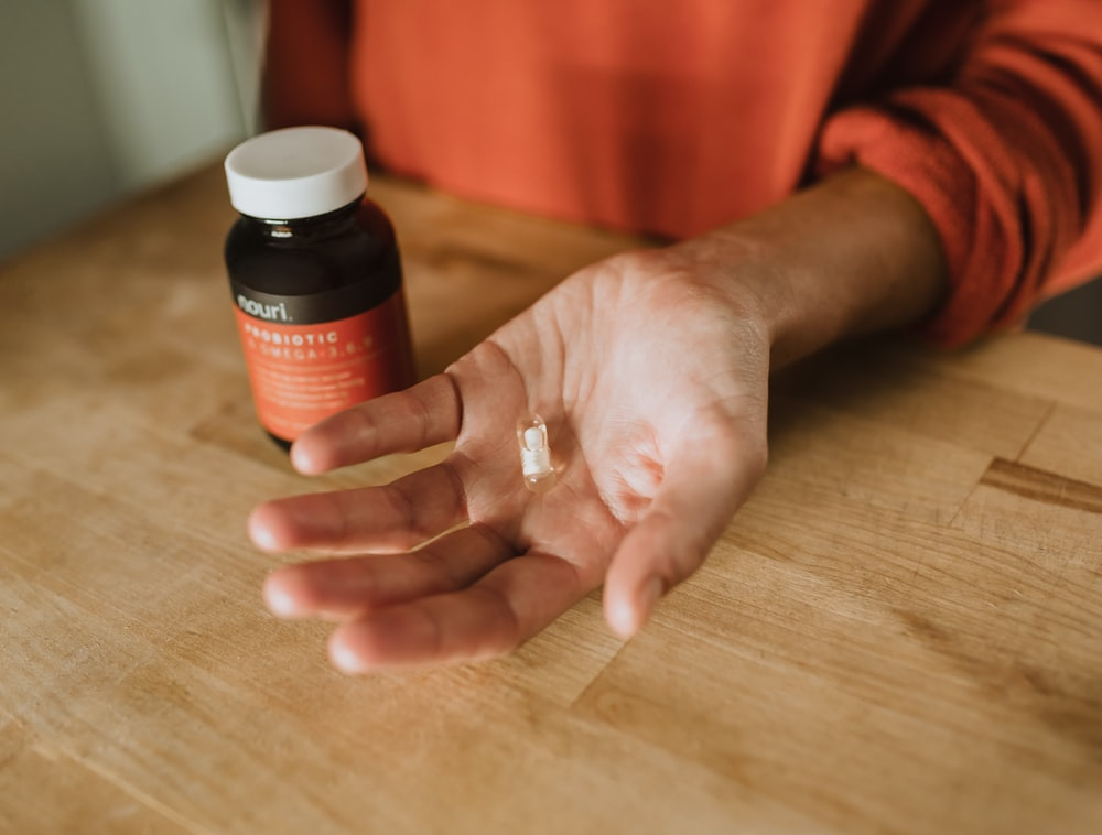 person holding medication pill
